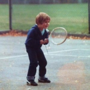 Nick Neacsu playing tennis as a child.